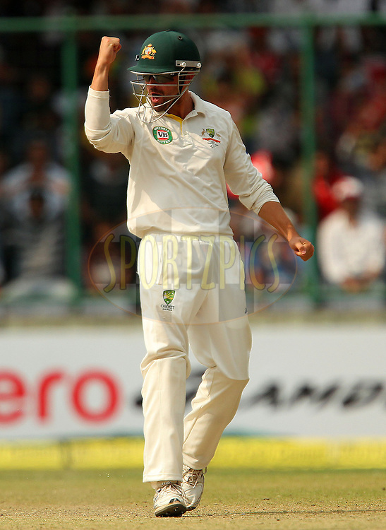 Ed Cowan of Australia celebrates the wicket of Virat Kohli of India during day 3 of the 4th Test Match between India and Australia held at the Feroz Shah Kotla stadium in Delhi on the 24th March 2013..Photo by Ron Gaunt/BCCI/SPORTZPICS ..Use of this image is subject to the terms and conditions as outlined by the BCCI. These terms can be found by following this link:..http://www.sportzpics.co.za/image/I0000SoRagM2cIEc