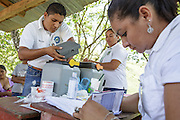 A health worker pulls vaccines from a cold box during a vaccination session at the primary school in the town of Coyolito, Honduras on Wednesday April 24, 2013.
