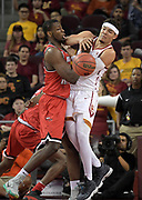 Western Kentucky Hilltoppers forward Dwight Coleby (22) and Southern California Trojans guard Jordan Usher (1) battle for the ball during an NCAA college basketball game in the second round of the NIT tournament in Los Angeles, Monday, Mar 19, 2018. WKU defeated USC 79-75.