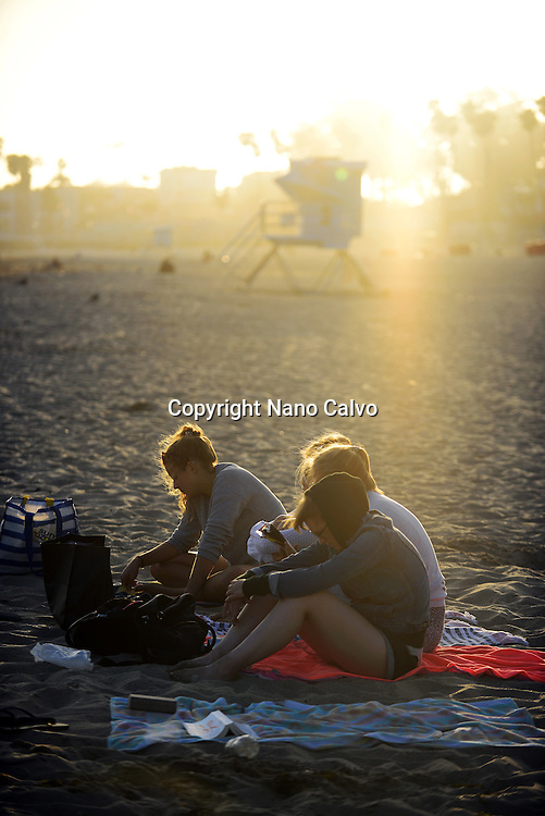 Group of young friends on Santa Cruz State beach, California.