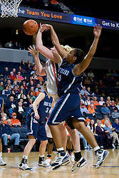 Rhode Island guard Lindsey Harris (15) fouls Virginia forward/center Abby Robertson (30) while in the act of shooting.  The Virginia Cavaliers women's basketball team defeated the Rhode Island Rams 89-53 at the John Paul Jones Arena in Charlottesville, VA on January 9, 2008.