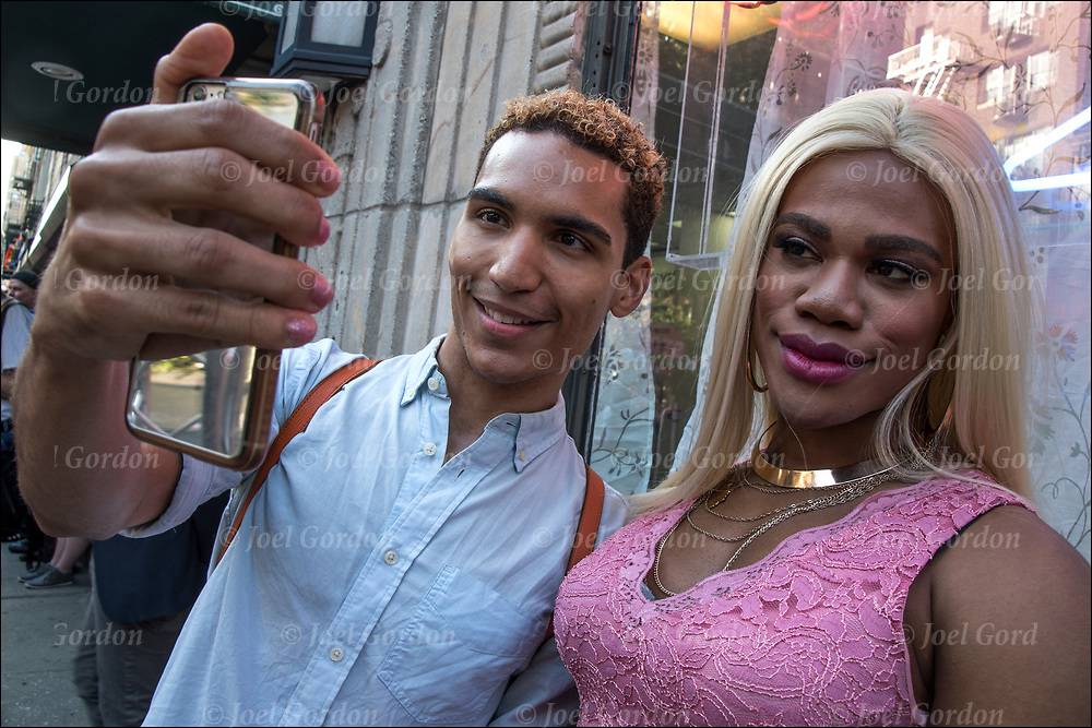 Justin Sams and friend taking selfie.<br />