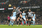 Joselu heads the ball away during the Premier League match between Manchester City and Newcastle United at the Etihad Stadium, Manchester, England on 20 January 2018. Photo by George Franks.
