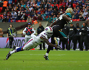 Buffalo Bills Duke Williams tackling Jacksonville Jaguars T.J. Yeldon during the Buffalo Bills v Jacksonville Jaguars NFL International Series match at Wembley Stadium, London, England on 25 October 2015. Photo by Matthew Redman.