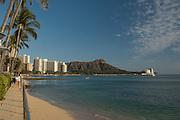 A view down Waikiki Beach with Diamond Head Crater in the background.