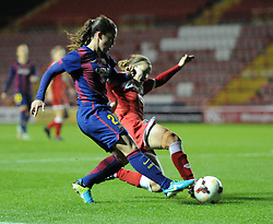 Bristol Academy Womens' Loren Dykes intercepts FC Barcelona's Nuria Garrote - Photo mandatory by-line: Paul Knight/JMP - Mobile: 07966 386802 - 13/11/2014 - SPORT - Football - Bristol - Ashton Gate Stadium - Bristol Academy v FC Barcelona - UEFA Women's Champions League