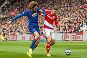 Manchester United midfielder Marouane Fellaini (27) battles with Middlesbrough midfielder Gaston Ramirez (21)  during the Premier League match between Middlesbrough and Manchester United at the Riverside Stadium, Middlesbrough, England on 19 March 2017. Photo by Simon Davies.
