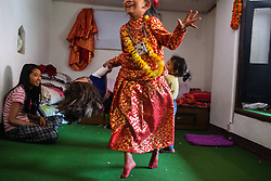 Off duty, Unika Vajracharya displays the exuberance of any child, but she's never reprimanded. In games with her little brother and older sister, she's always the boss. No one risks the wrath of a living goddess.