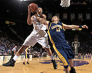Dec 09, 2007; Manhattan, KS, USA; Kansas State Wildcats forward Michael Beasley (30) pulls down a offensive rebound against California Bears forward Harper Kamp (43) in the first half at Bramlage Coliseum in Manhattan, KS. Kansas State defeated California 82-75. Mandatory Credit: Peter G. Aiken-US PRESSWIRE