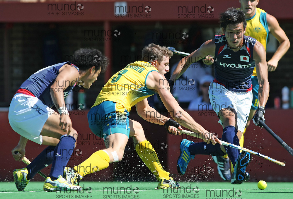 (Canberra, Australia---31 March 2012) Simon Orchard of the Australia Kookaburra national field hockey team paying the second of a three game field hockey test match series between Australia and Japan men's field hockey teams. 2012 Copyright Photograph Sean Burges / Mundo Sport Images.