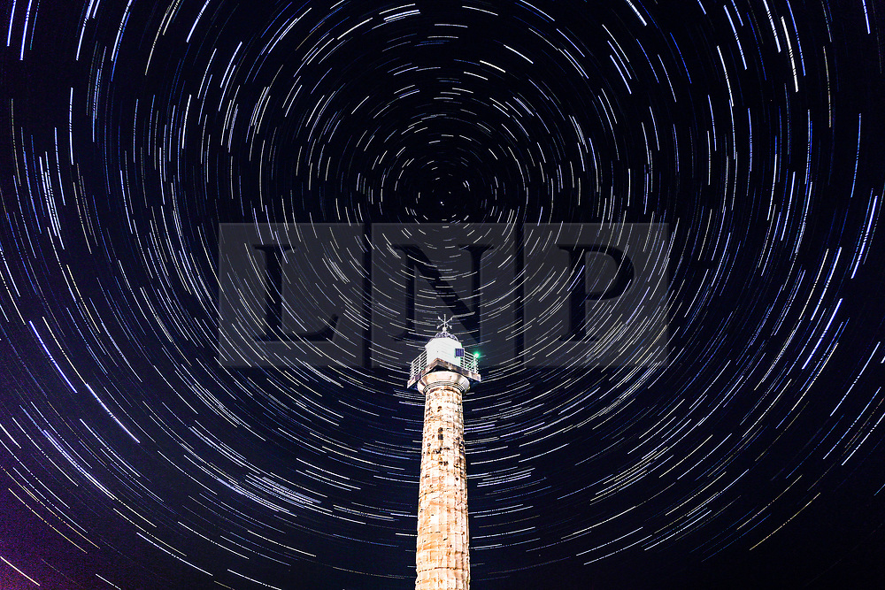 © Licensed to London News Pictures. 19/04/2018. Whitby UK. A composite picture shows star trails over Whitby lighthouse on a clear night in Whitby last night. Photo credit: Andrew McCaren/LNP