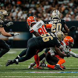 Sep 16, 2018; New Orleans, LA, USA; New Orleans Saints linebacker Demario Davis (56) tackles Cleveland Browns quarterback Tyrod Taylor (5) during the fourth quarter of a game at the Mercedes-Benz Superdome. The Saints defeated the Browns 21-18. Mandatory Credit: Derick E. Hingle-USA TODAY Sports