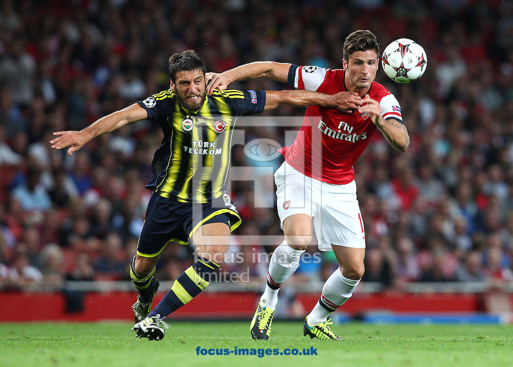 Picture by Paul Terry/Focus Images Ltd +44 7545 642257<br /> 27/08/2013<br /> Olivier Giroud of Arsenal is challenged by Egemen Korkmaz of Fenerbahce SK during the UEFA Champions League match at the Emirates Stadium, London.