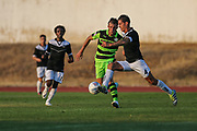 Forest Green Rovers Christian Doidge(9) is beaton to the ball during the Pre-Season Friendly match between SC Farense and Forest Green Rovers at Estadio Municipal de Albufeira, Albufeira, Portugal on 25 July 2017. Photo by Shane Healey.
