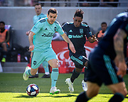 Seattle Sounders midfielder Victor Rodriguez (8) dribbles the ball past LAFC forward Latif Blessing (7) during a MLS soccer match in Los Angeles, Sunday, April 21, 2019. LAFC defeated the Sounders 4-1. (Ed Ruvalcaba/Image of Sport)