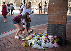 © Licensed to London News Pictures. 22/06/2020. Reading, UK. 18 year old Emily and her mother Sally lay flowers near Forbury Gardens in Reading town centre, where three people were stabbed to death in a terrorist attack. Several other people were injured in the attack which was carried out by Libyan asylum seeker Khairi Saadallah, who is currently in custody. . Photo credit: Ben Cawthra/LNP