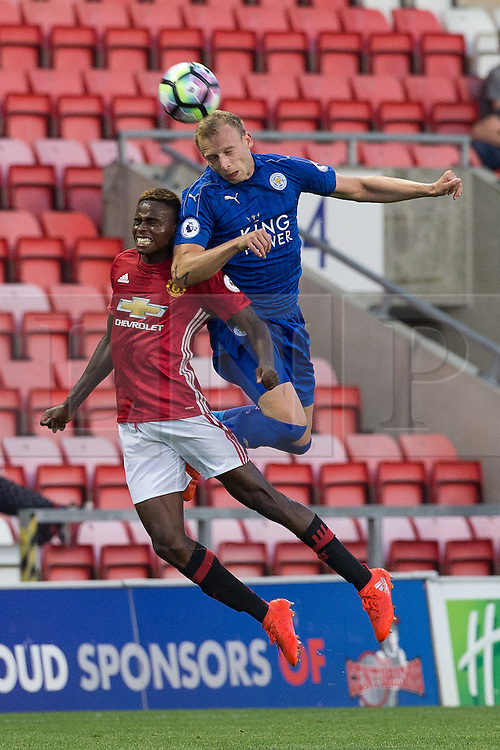 © Licensed to London News Pictures . 15/08/2016 . Leigh , UK . MATTHEW OLOSUNDE doesn't quite make the ball . Manchester United vs Leicester City reserves at Leigh Sports Village Stadium . Photo credit : Joel Goodman/LNP