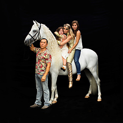 Portrait of Kanat and Tatiana Tchalabaeva with their kids Veronica and Angelica. The parents lead The Thundering Cossack Warriors in the show.<br />