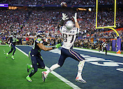 New England Patriots tight end Rob Gronkowski (87) leaps and catches a 22 yard touchdown pass that gives the Pats a 14-7 second quarter lead while covered by Seattle Seahawks outside linebacker K.J. Wright (50) during the NFL Super Bowl XLIX football game against the Seattle Seahawks on Sunday, Feb. 1, 2015 in Glendale, Ariz. The Patriots won the game 28-24. ©Paul Anthony Spinelli