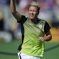 ORLANDO, FL - OCTOBER 25: Abby Wambach #20 of USWNT salutes fans with a peace sign as she jogs off the field after warmups during a women's international friendly soccer match between Brazil and the United States at the Orlando Citrus Bowl on October 25, 2015 in Orlando, Florida. (Photo by Alex Menendez/Getty Images) *** Local Caption *** Abby Wambach