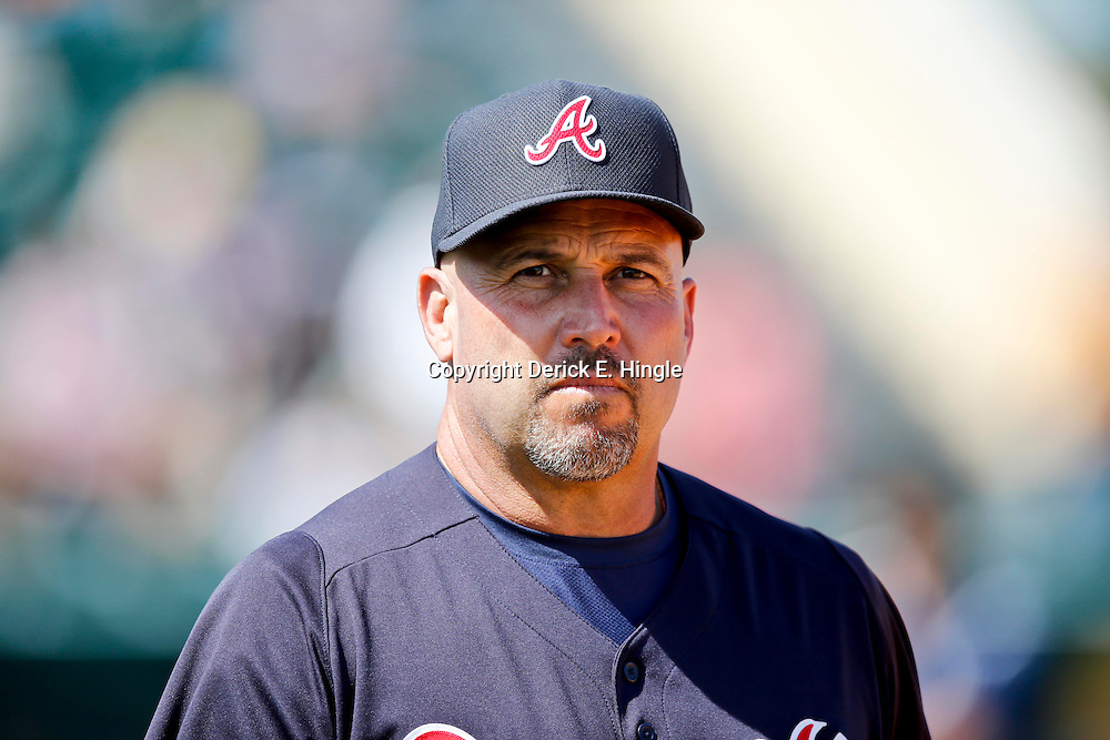 Feb 27, 2013; Lakeland, FL, USA; Atlanta Braves manager Fredi Gonzalez (33) against the Detroit Tigers during the a spring training game at Joker Marchant Stadium. Mandatory Credit: Derick E. Hingle-USA TODAY Sports