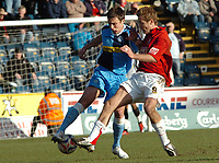 Photo: Kevin Poolman.<br />Wycombe Wanderers v Walsall. Coca Cola League 2. 17/03/2007. Sam Stockley of Wycombe (left) is tackled by Martin Butler of Walsall.