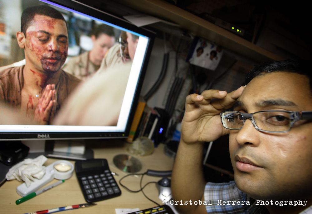 Hugo Gonzalez, retired US Army Specialist, shows, in his computer, one of the pictures of him, taked in Iraq by a Washington Post photographer when he was injured by an improvised explosive device June 21, 2004, while serving is the US Army in Iraq. Hollywood on Tuesday June 16, 2009.  Staff photo/Cristobal Herrera....