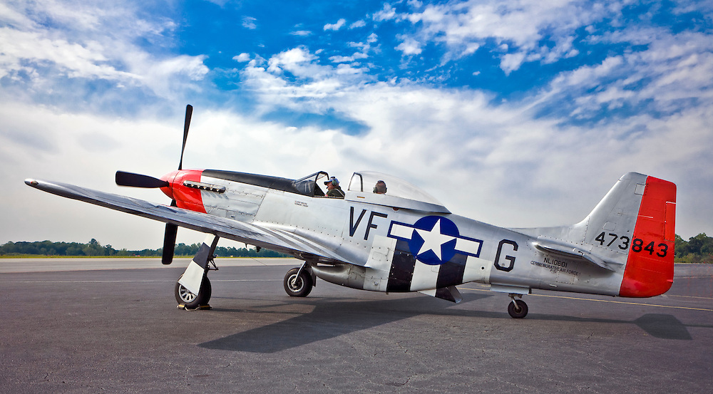 "P-51 D model ""Mustang"" fighter plane on the ramp at Atlanta's PDK airport.  Owned and operated by the Dixie Wing of the Commemorative Air Force."