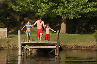 Family Jumping into Lake