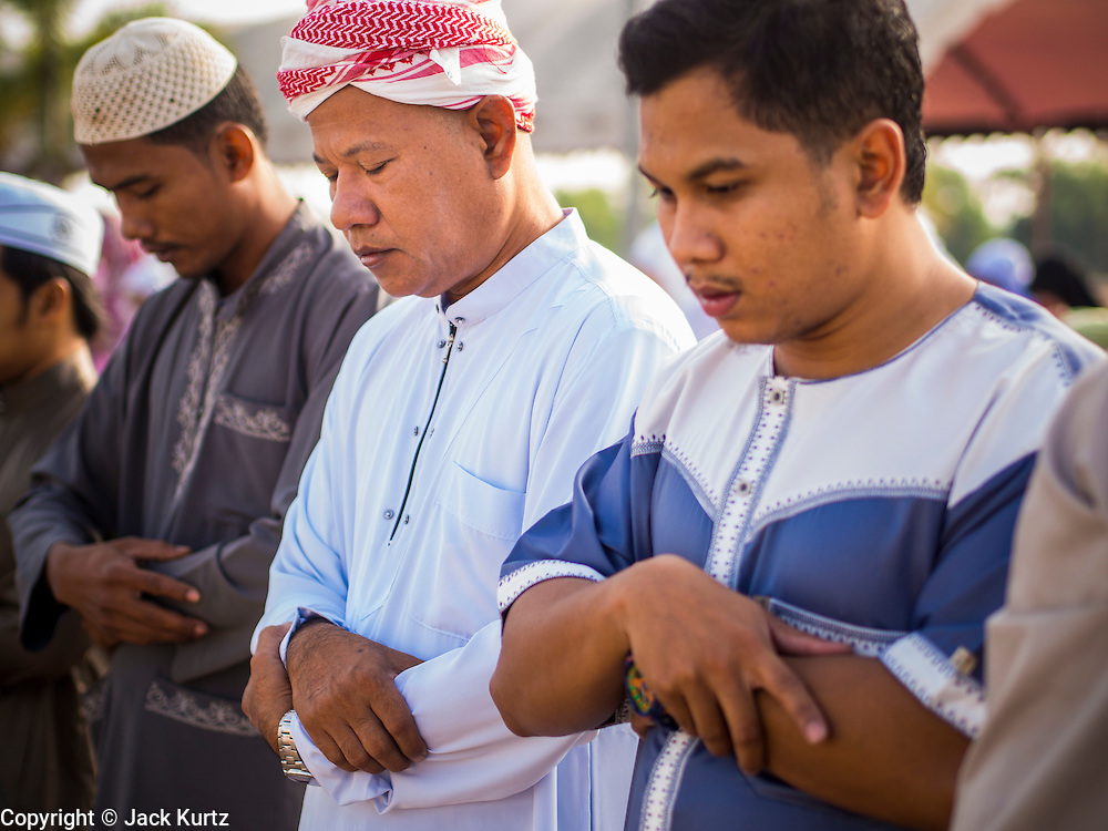 Men pray during Eid at Songkhla Central Mosque in Songkhla province of Thailand. Eid al-Fitr is also called Feast of Breaking the Fast, the Sugar Feast, Bayram (Bajram), the Sweet Festival and the Lesser Eid, is an important Muslim holiday that marks the end of Ramadan, the Islamic holy month of fasting.