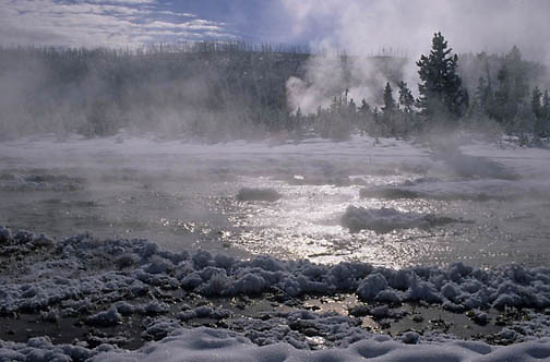Yellowstone National Park, Midway Geyser Basin billows steam from thermal area.