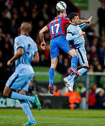 Glenn Murray of Crystal Palace and Martin Demichelis of Manchester City compete in the air - Photo mandatory by-line: Rogan Thomson/JMP - 07966 386802 - 06/04/2015 - SPORT - FOOTBALL - London, England - Selhurst Park - Crystal Palace v Manchester City - Barclays Premier League.