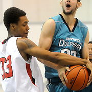 Brunswick Community College's Kyle Rhoedes drives against Catonsville's Amir Boney Sunday November 9, 2014 at Cape Fear Community College in Wilmington, N.C. (Jason A. Frizzelle)