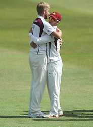 Olly Stone of Northamptonshire celebrates with team mates as Hamish Marshall of Gloucestershire is caught by Alex Wakely bowled by Stone - Photo mandatory by-line: Dougie Allward/JMP - Mobile: 07966 386802 - 09/07/2015 - SPORT - Cricket - Cheltenham - Cheltenham College - LV=County Championship 2
