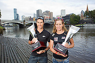 "Craig Alexander (AUS) holding the ""Greg Welch Trothy"" and Caroline Steffen (SUI) holding the ""Michellie Jones Trothy"", Winners of the inaugural Ironman Melbourne Triathlon with the  and Melbourne city in the background.Post Race Trophy Shoot. 2012 Ironman Melbourne. Asia-Pacific Championship. 26/03/2012. Photo By Lucas Wroe."