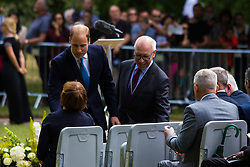 Hyde Park, London, July 7th 2015. Families of the victims and survivors of the 7/7 bombings in London gather at Hyde Park and are joined by the Duke of Cambridge Prince William at an emotional service commemorqating the Islamist terrorist bombing outrage that happened on London's transport network, claiming 57 lives and left scores of people injured. PICTURED: Prince William greets Tessa Jowell as he arrives at the ceremony