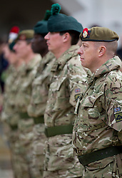 © Licensed to London News Pictures. 04/11/2012. London, UK. Territorial Soldiers of Vimy Company, the London Regiment, stand on parade at Guildhall in London today (04/11/12).  The 52 reservists of Vimy Company, who come from all walks of life, paraded at Guildhall to be presented with their Operational Service Medals after returning from operations in Afghanistan.  Photo credit: Matt Cetti-Roberts/LNP