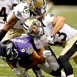 Aug 28, 2014; New Orleans, LA, USA; New Orleans Saints safety Vinnie Sunseri (43) tackles Baltimore Ravens wide receiver Michael Campanaro (6) during the second half of a preseason game at Mercedes-Benz Superdome. The Ravens defeated the Saints 22-13. Mandatory Credit: Derick E. Hingle-USA TODAY Sports