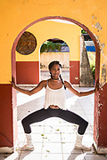 """Arletis Francis, 26, photographed here at one of Havana's beloved salsa clubs, grew up in Guantanamo and came to Havana to study engineering. """"I was so sad to leave my family but I knew I had to come here if I wanted to study,"""" she says. She currently teaches computer skills to high school students and teaches salsa dancing on the side. """"My dream is to become a professional salsa dancer but is it very difficult. You have to get special papers to get the jobs that pay well, she explains. """"Actually, even now I make less as a computer teacher than a dancer and I also love to dance,"""" she adds. Of Cuban women, she says """"we are strong, fight hard, wake up every day to solve our family's problems and we are resilient."""""""