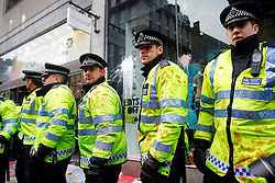 © under license to London News Pictures.  26/03/11 Police defend Topshop from attacks by protestors at the massive Anti-cuts march in London. Photo credit should read: Olivia Harris/ London News Pictures