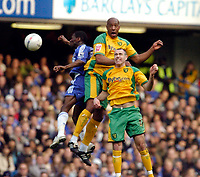 Photo: Leigh Quinnell.<br /> Chelsea v Norwich City. The FA Cup. 17/02/2007.<br /> Norwichs' Dion Dublin rises with team mate Andy Hughes and Chelseas Shaun Wright-Phillips.