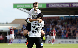 Gwion Edwards of Peterborough United celebrates scoring the opening goal with team-mate Junior Morias - Mandatory by-line: Joe Dent/JMP - 26/08/2017 - FOOTBALL - Sixfields Stadium - Northampton, England - Northampton Town v Peterborough United - Sky Bet League One