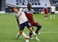 Giovani Lo Celso of Tottenham holds off Michail Antonio of West Ham United  during the Premier League match at the Tottenham Hotspur Stadium, London. Picture date: 23rd June 2020. Picture credit should read: David Klein/Sportimage
