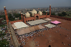 June 26, 2017 - Lahore, Punjab, Pakistan - Pakistani faithful Muslims take a part of Eid al-Fitr prayer at the historical Badshahi Mosque in Lahore. Muslims around the world are celebrating the Eid al-Fitr  festival, marking the end of the fasting month of Ramadan. (Credit Image: © Rana Sajid Hussain/Pacific Press via ZUMA Wire)