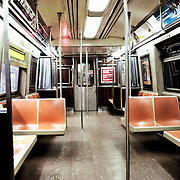 A subway car, traveling between Brooklyn and Manhattan on the New York City subway system, sits empty at Canal Street, the stop for China Town.