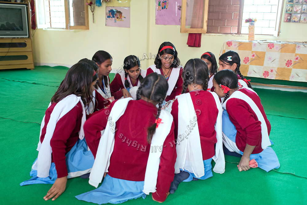 Ritu Gaur, 13, is talking to other pupils during a Skills Development class in the Jamoniya Tank Girls Hostel, near Sehore, Madhya Pradesh, India, where the Unicef India Sport For Development Project has started in 2012. Covering 313 state-run girls' hostels and 207 mixed hostels in Madhya Pradesh, the project ensures that children from Scheduled Tribes (ST) and others amongst the poorest people in India, can easily access education and be introduced to sports. Field workers from Unicef also oversee their nutrition and monitor the overall conditions of each pupil.