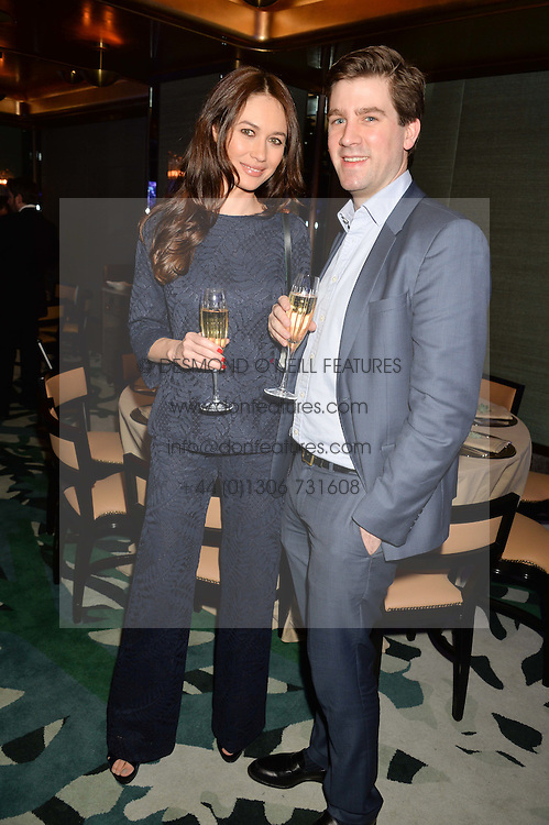 OLGA KURYLENKO and MAX BENITZ at a dinner hosted by Creme de la Mer to celebrate the launch of Genaissance de la Mer The Serum Essence held at Sexy Fish, Berkeley Square, London on 21st January 2016.