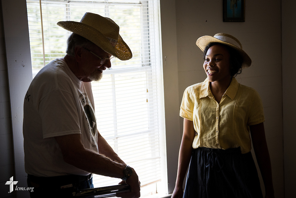 Director Dr. Ardon Albrecht consults with actress Jasmine Gatewood, performing the role as a young Rosa Young, during lunch at 'The First Rosa' filming on Wednesday, Sept. 24, 2014, at Hope Lutheran Church outside Selma, Ala. LCMS Communications/Erik M. Lunsford