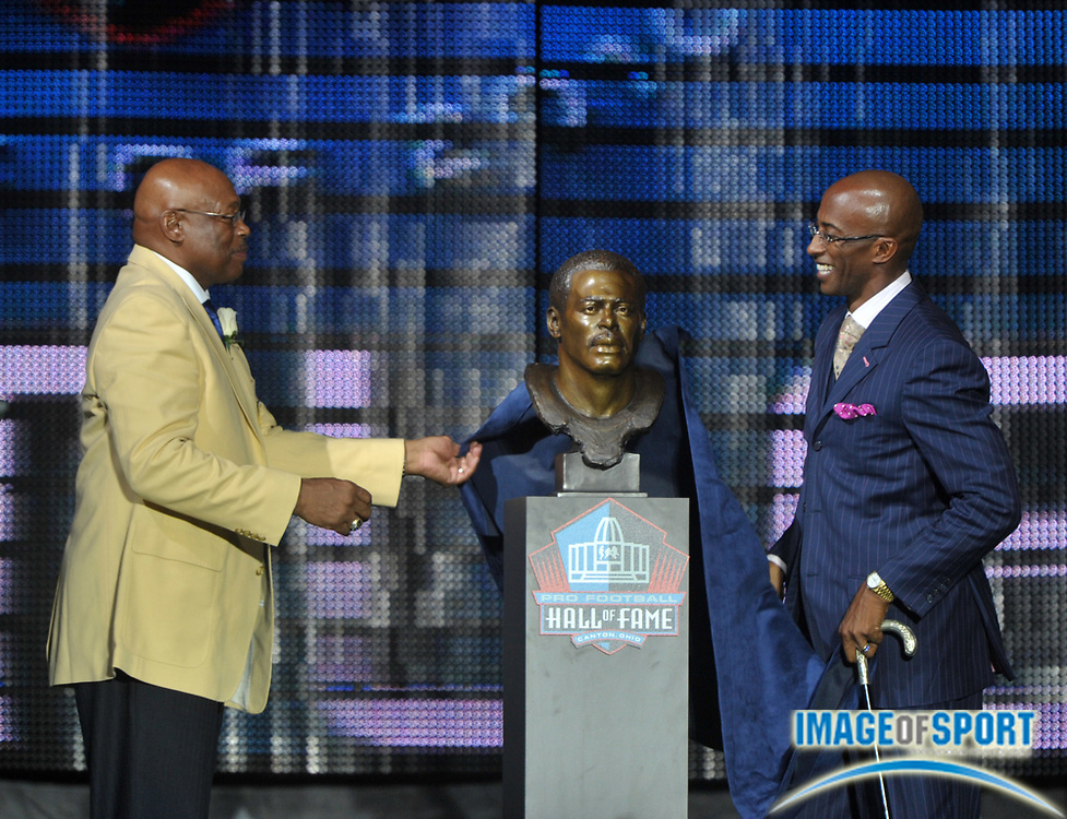 Aug 7, 2010; Canton, OH, USA; Floyd Little (left) and presenter Mark Little unveil the bust of Floyd Little at the 2010 Pro Football Hall of Fame enshrinement ceremony at Fawcett Stadium. Photo by Image of Sport