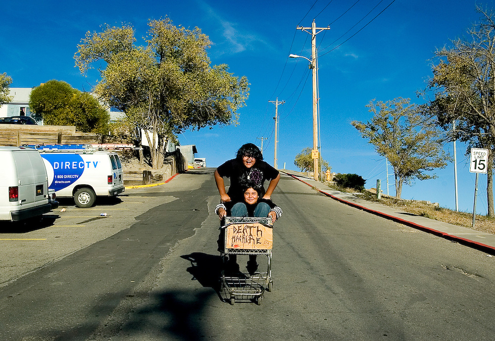 "102807       Brian Leddy.Dwight Harris pushes his friend Rowe Bitsilly in a shopping cart they labeled as the ""Death Machine"" in front of Terrace Apartments on Sunday afternoon. The boys, both 13, have been using the cart for the past three days as a makeshift go-cart while taking turns pushing each other around."